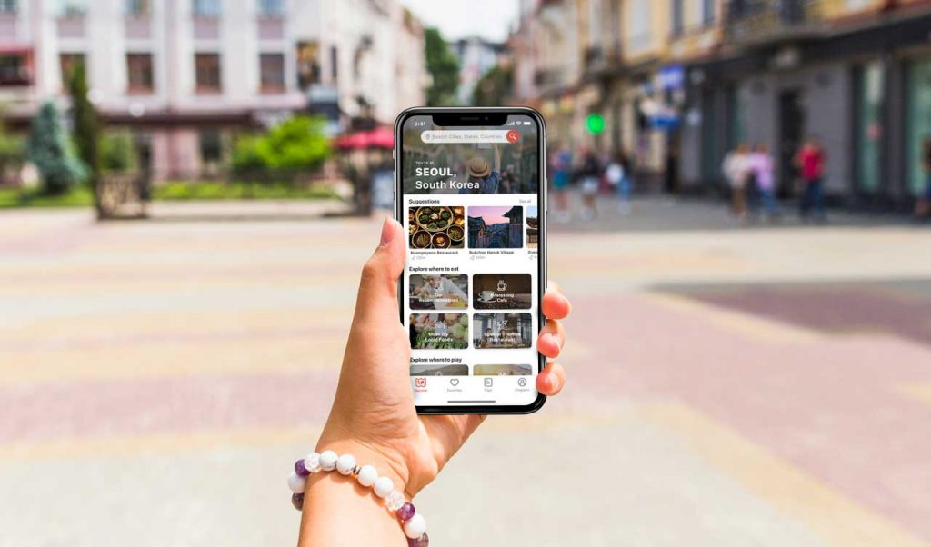 Traple App held by tourist